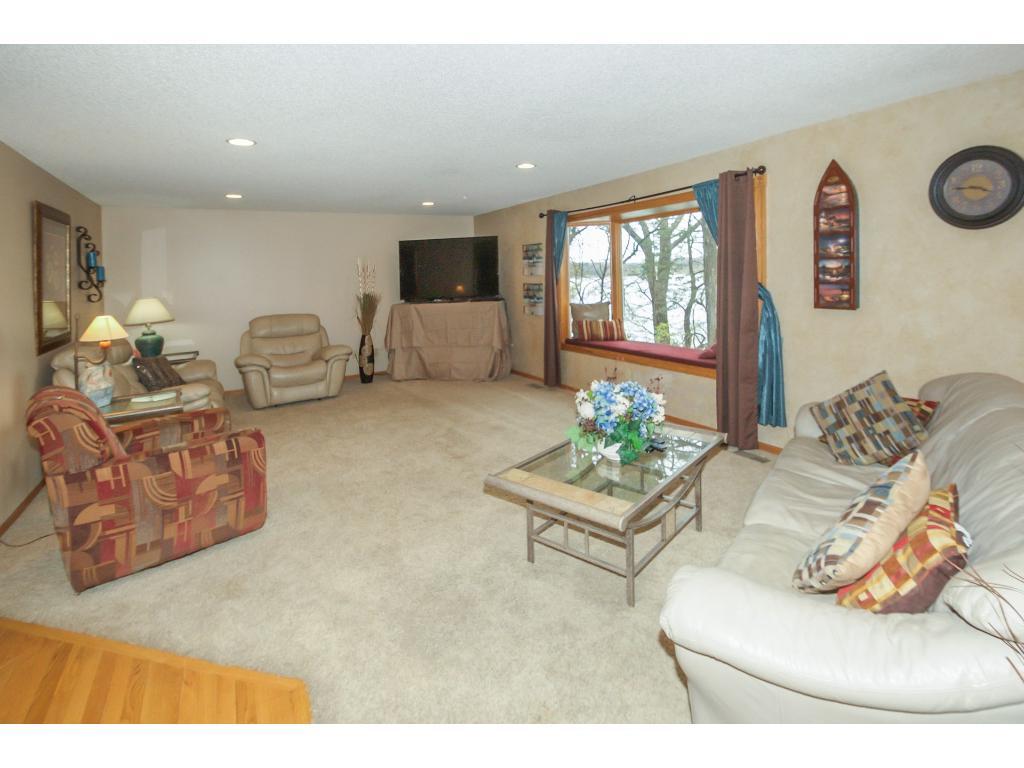 Spacious living room with gorgeous lake views.