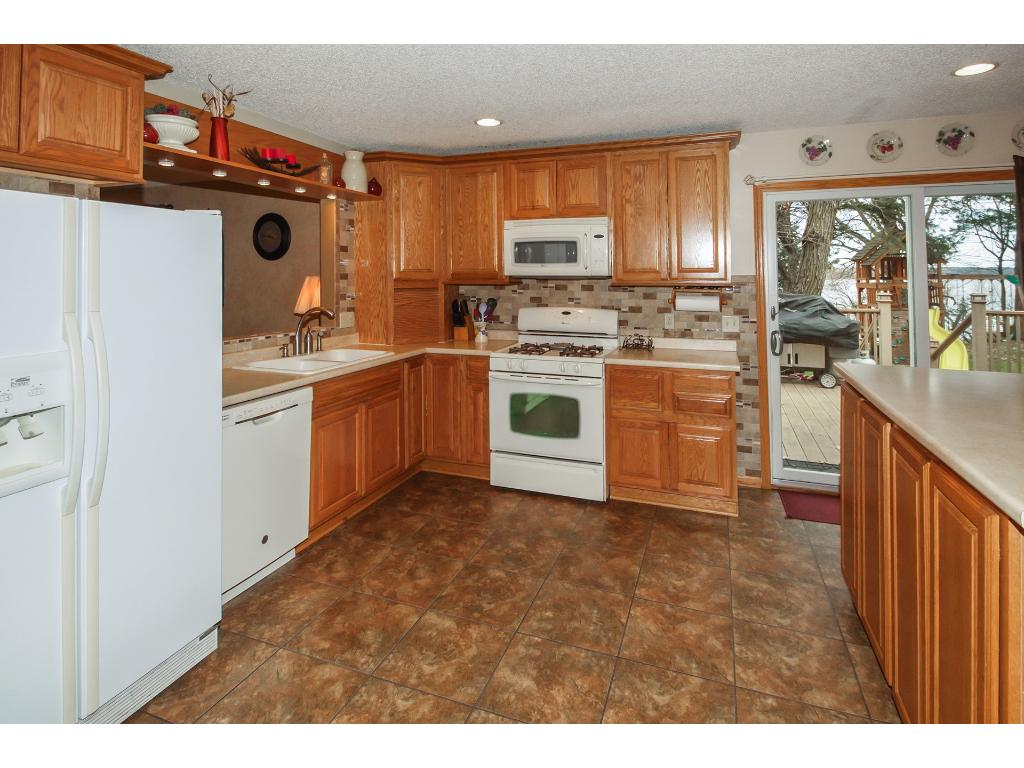 Kitchen walks out to lakeside deck - perfect for grilling and entertaining!