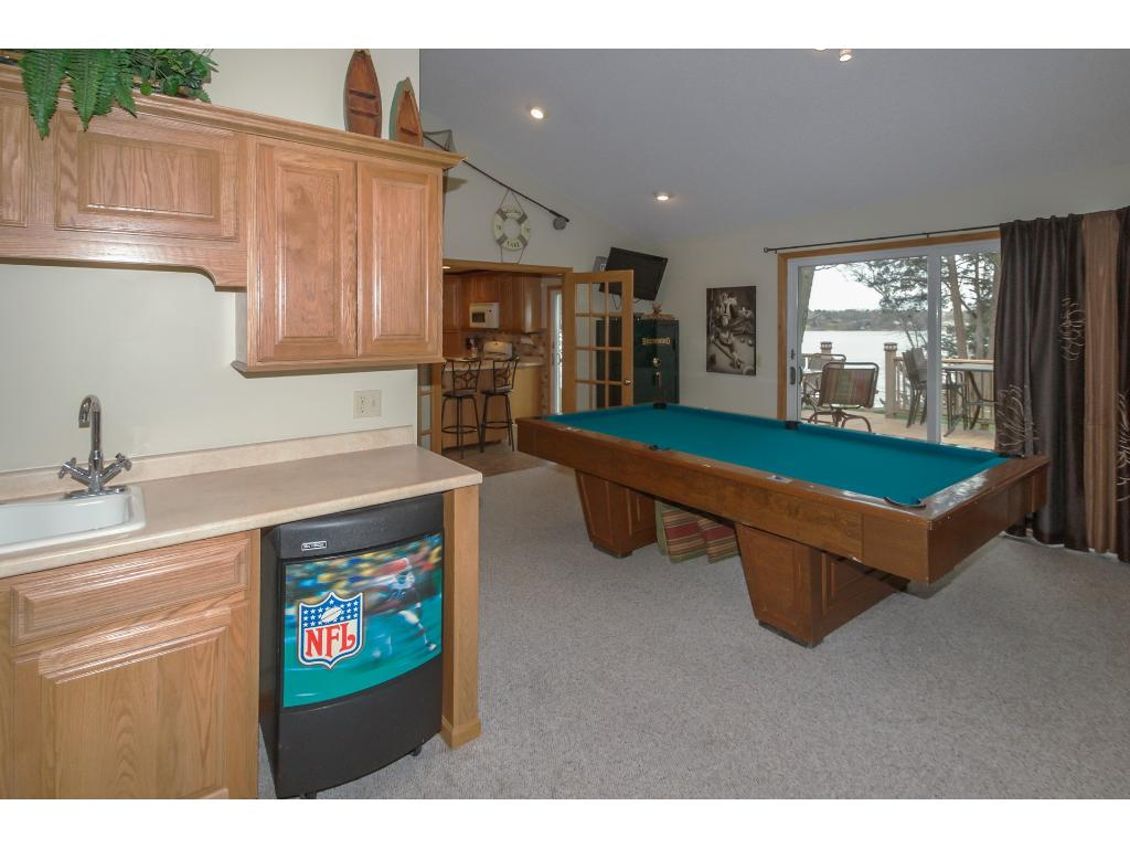 Fantastic lakeside family/game room with wet bar and gas fireplace.