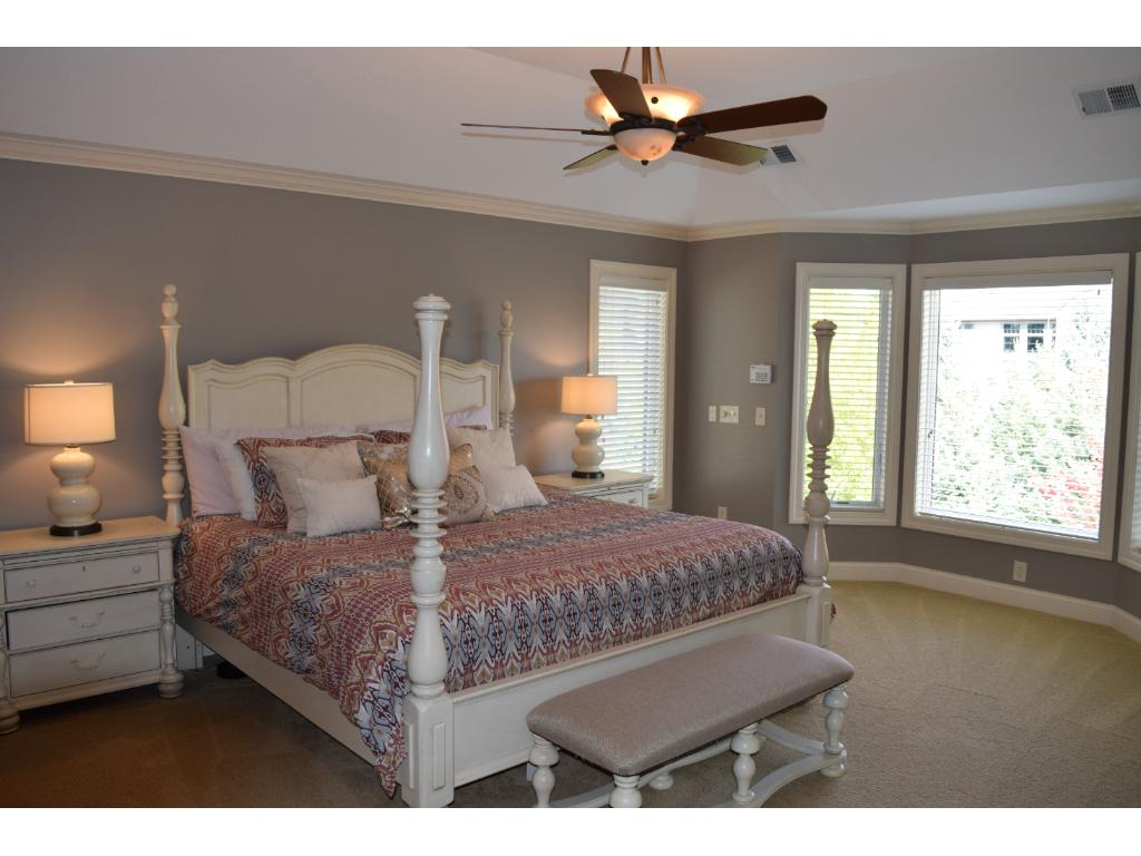 The large Master suite boasts a distinctive tray ceiling & large walk-in closets.  Note:  There are three separate heating zones within this home; upper level, main level and lower level.