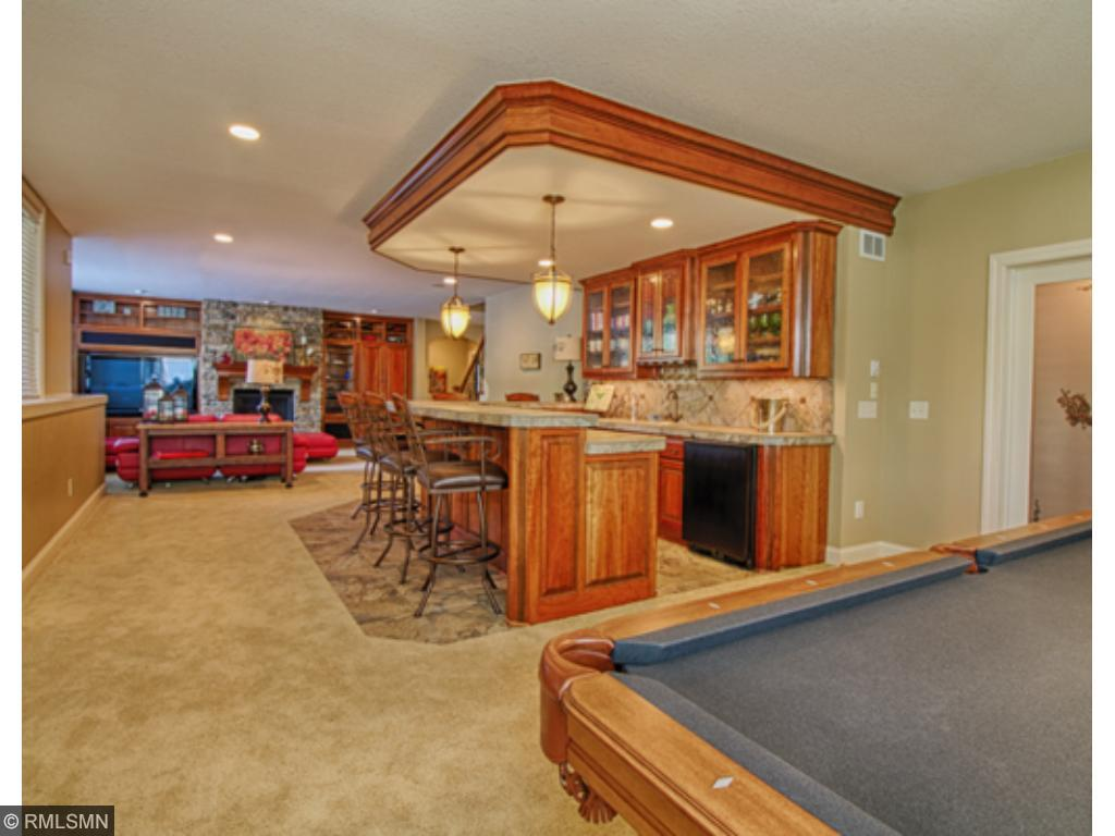 Lower level has a huge family room and massive bar area.  There's even additional room for a pool table!