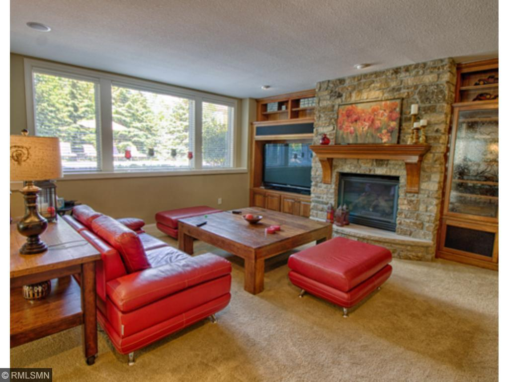 Family room is so warm and inviting featuring a gorgeous gas fireplace!