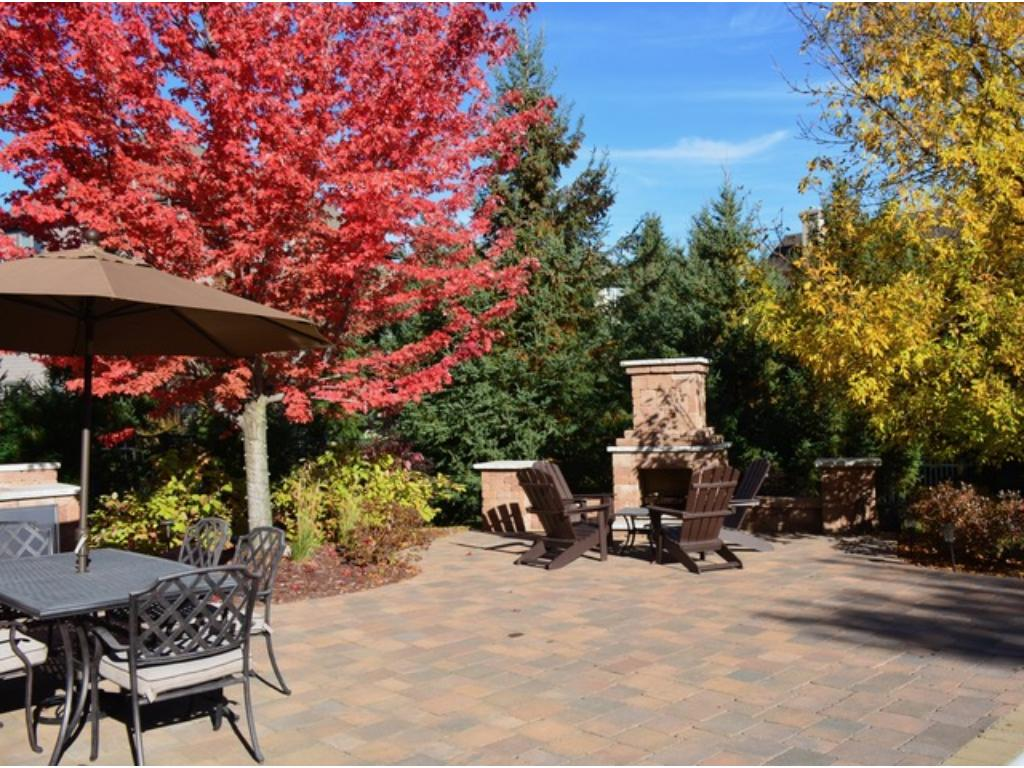 Spectacular outdoor living spaces ~ Current owners recently added the granite bar/grill, brick fireplace, fence and pool!