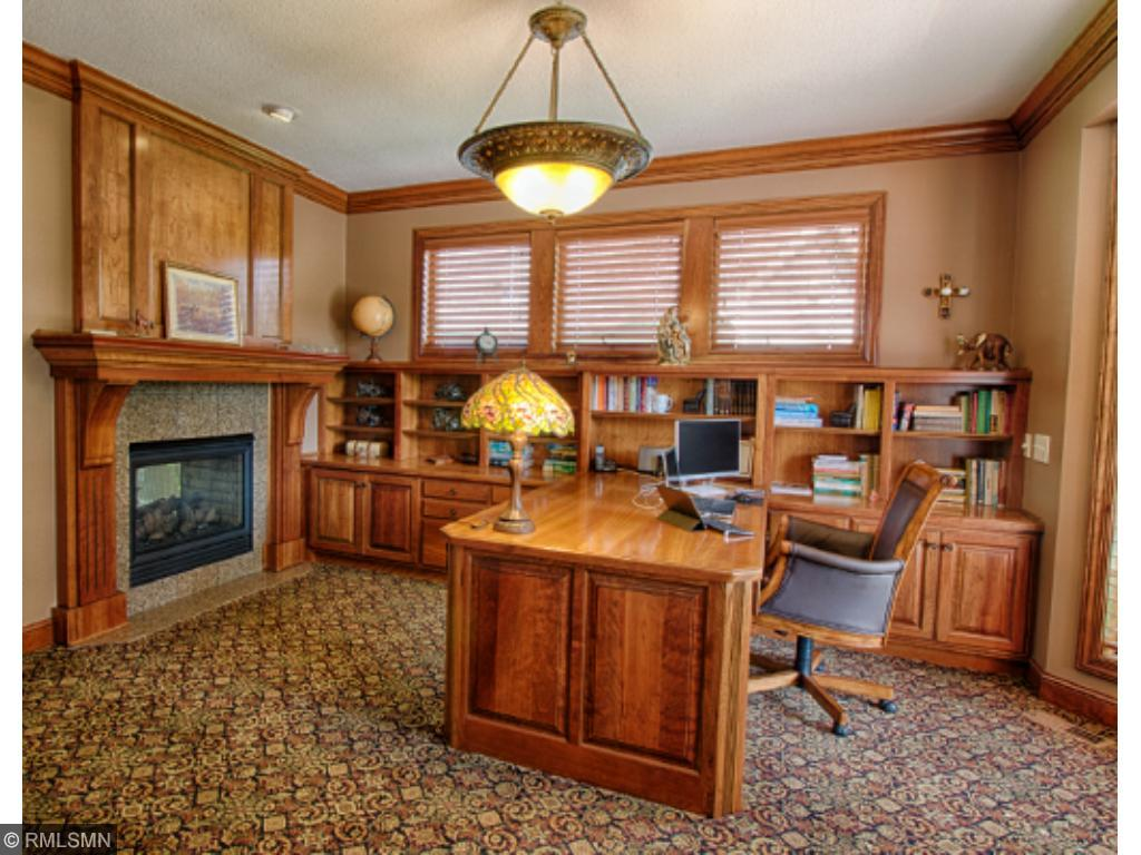 Amazing main floor office with a see-through gas fireplace to the Sun Room.