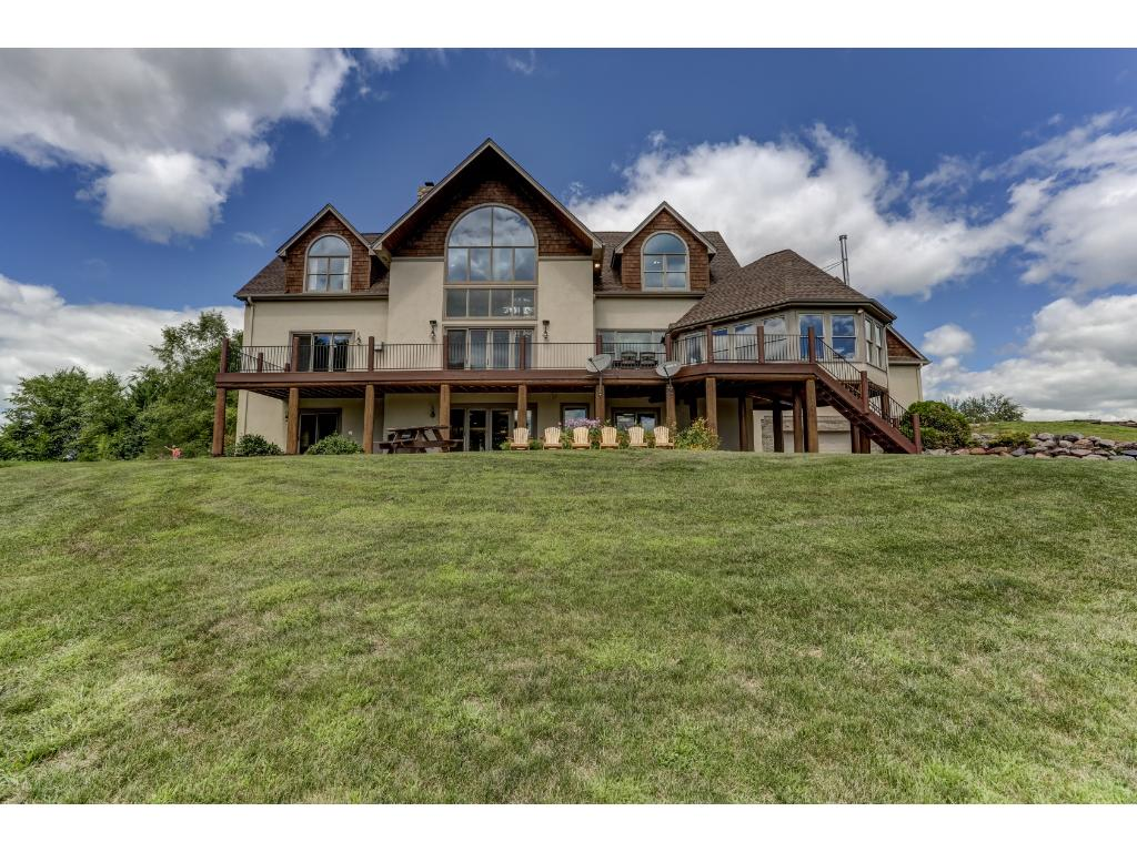 Lakeside of Home Features Large Deck & Patio with Built in Fire Pit
