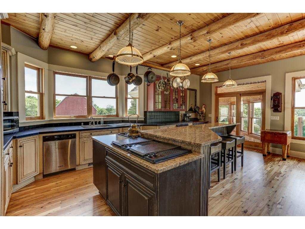 Center Island Kitchen has Entry to Sun Room