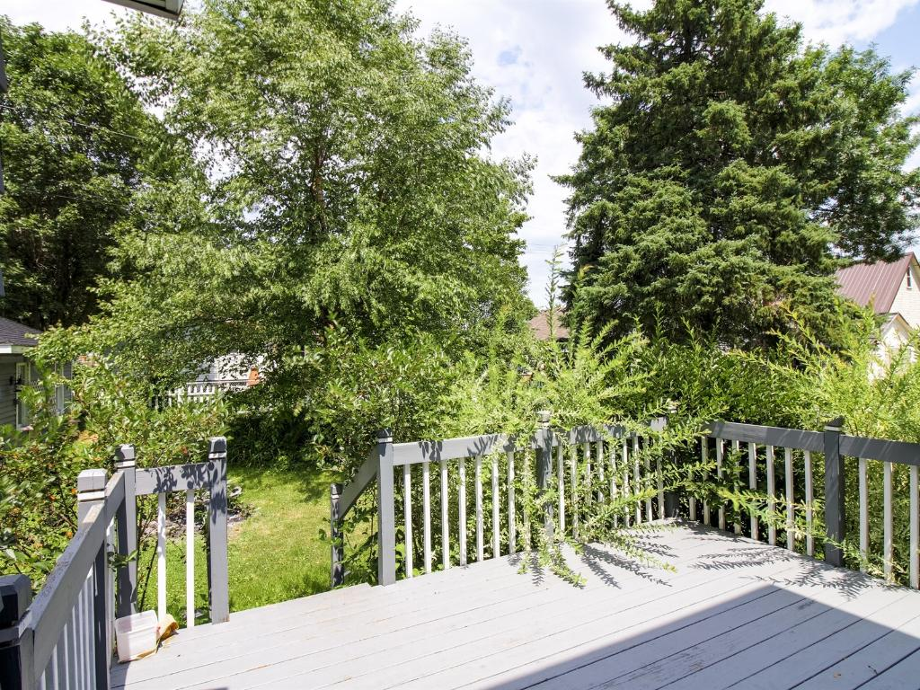 Deck off of dining room transitions nicely to the backyard.