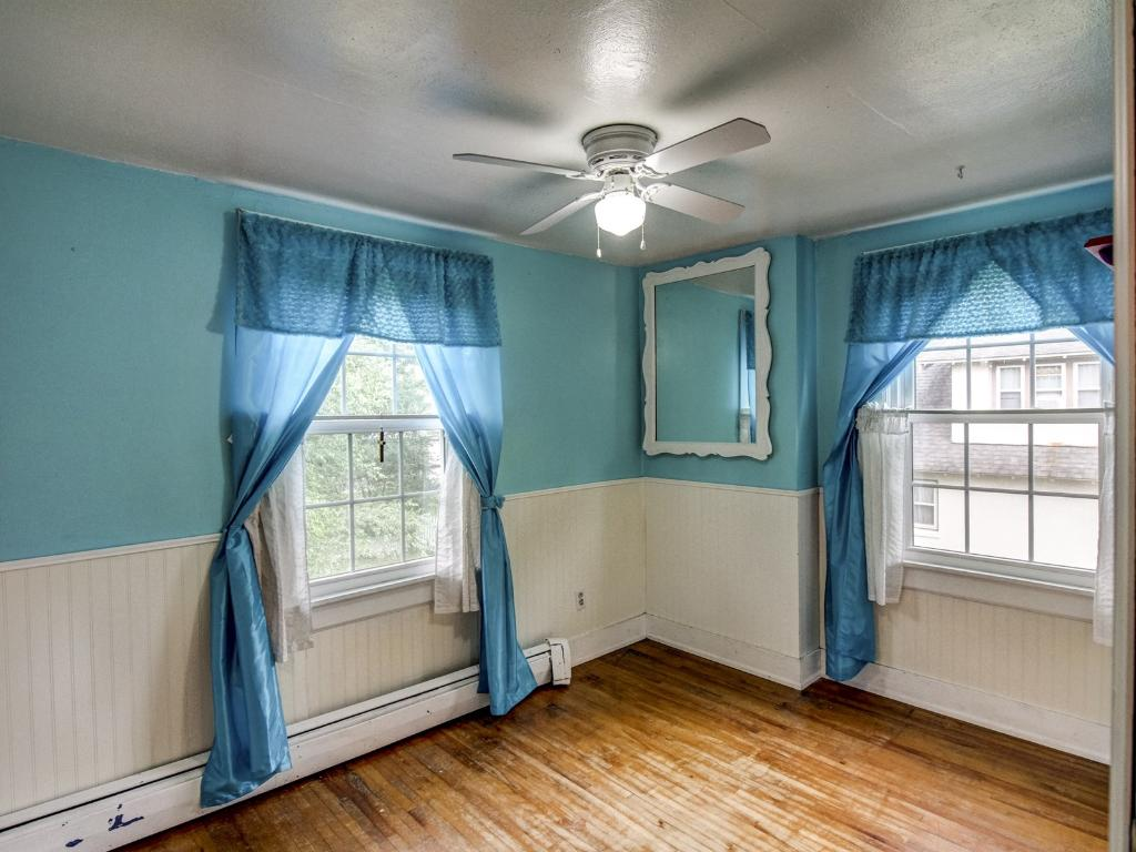 Bedroom #3 with hardwood floors and ceiling fan.