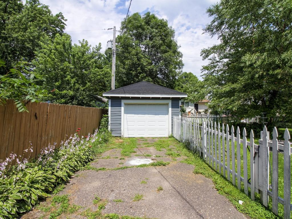 Garage in backyard with your own whit picket fence.