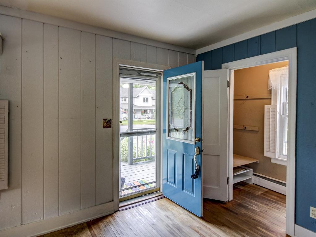 Front door open onto the living room.