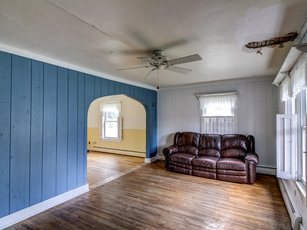 Hardwood floors and ceiling fans are great touches in the living room.