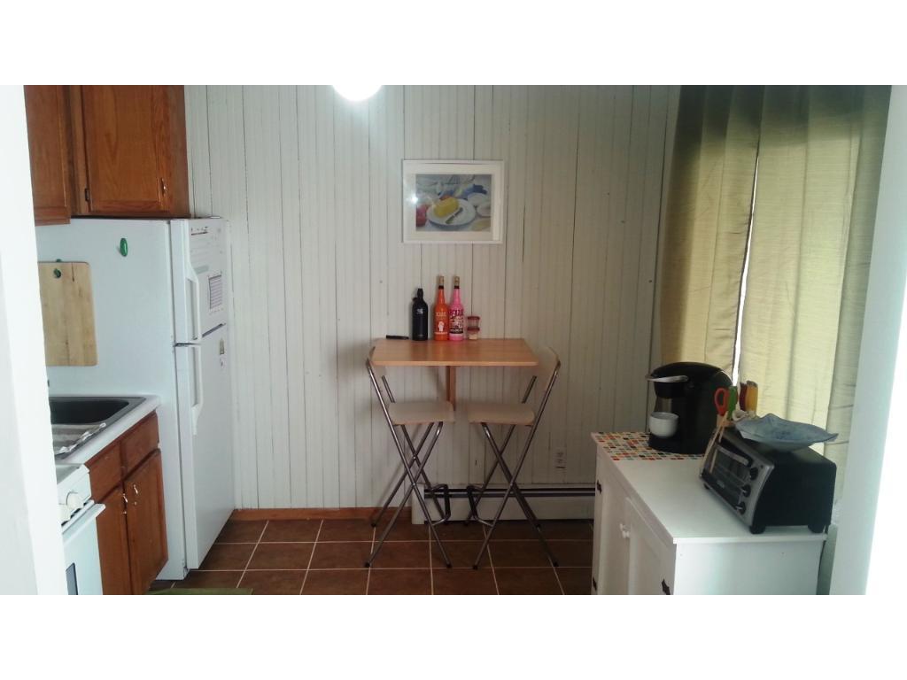 tile floors, updated oak cabinets nice 5 burner stove