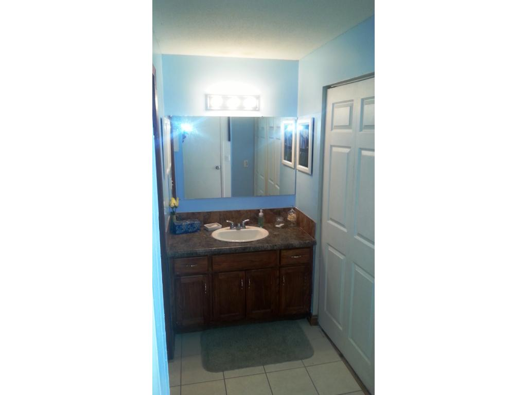 tile floors in bath with more closet space