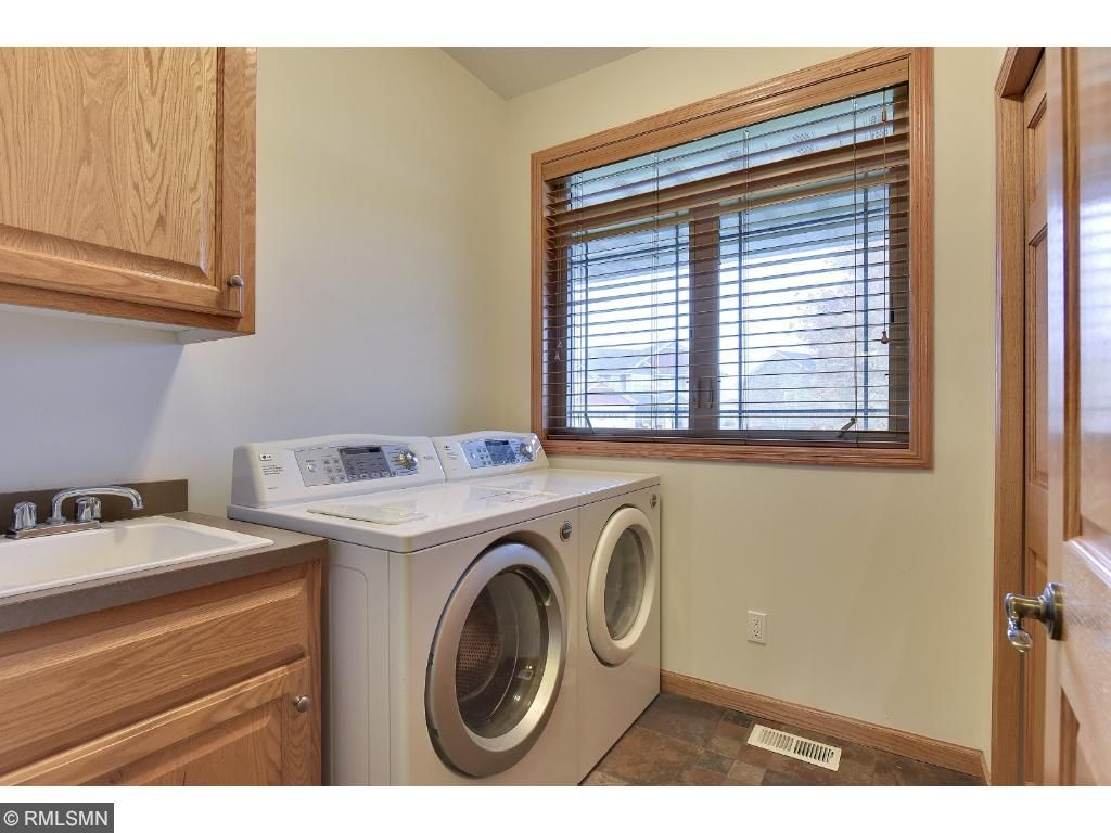 Convenient main level laundry with utility sink and storage