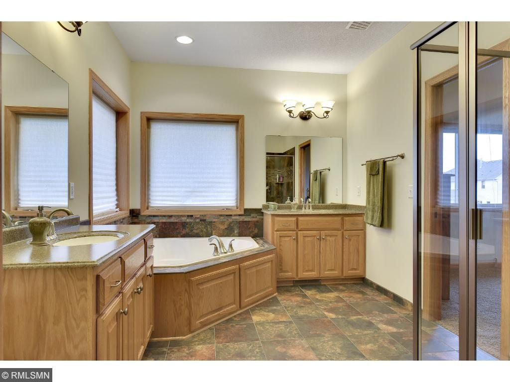 Such a lovely master bath! Separate jacuzzi tub and shower, walk-in closet and dual sinks.