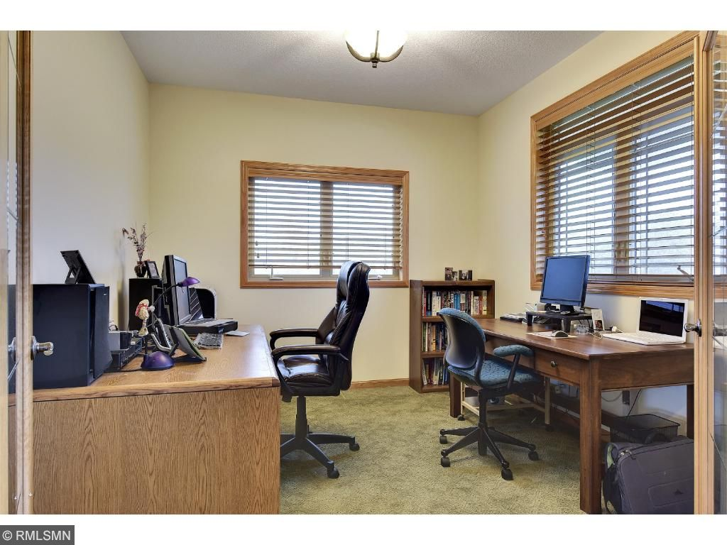 Adjacent to the foyer is the private office with french doors and plenty of light.