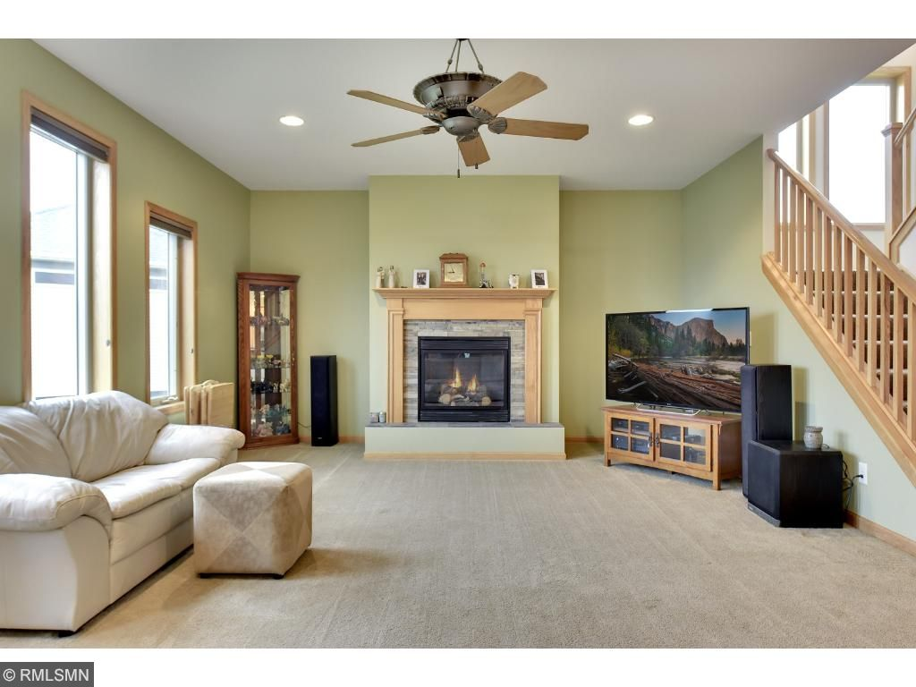 Main level family room with a bank of windows and gas fireplace