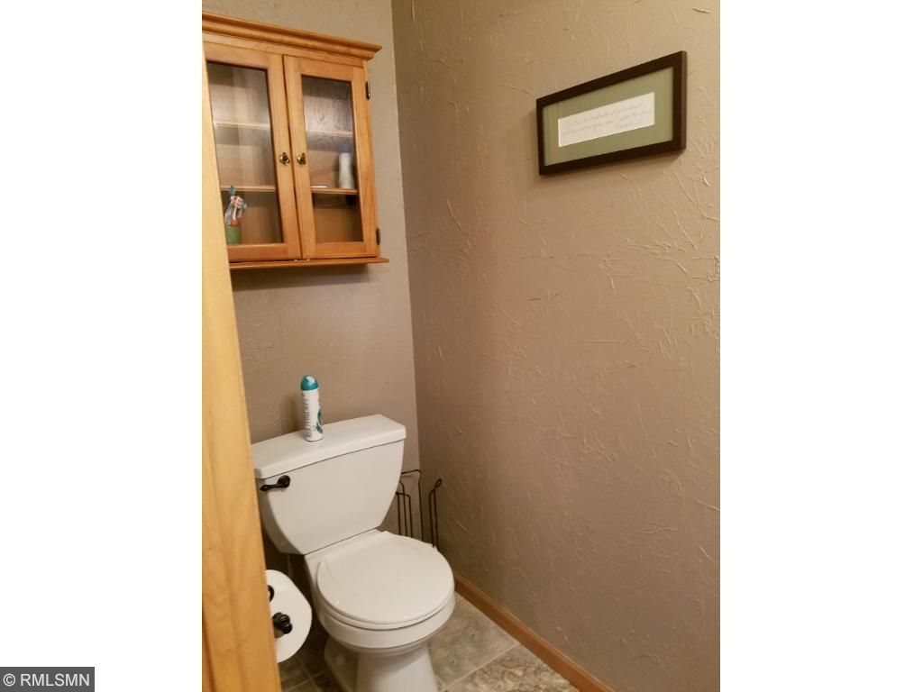 Updated bathroom with ceramic flooring.