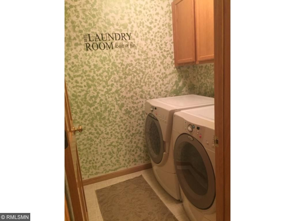 Convenient location for the laundry room with cabinets above.
