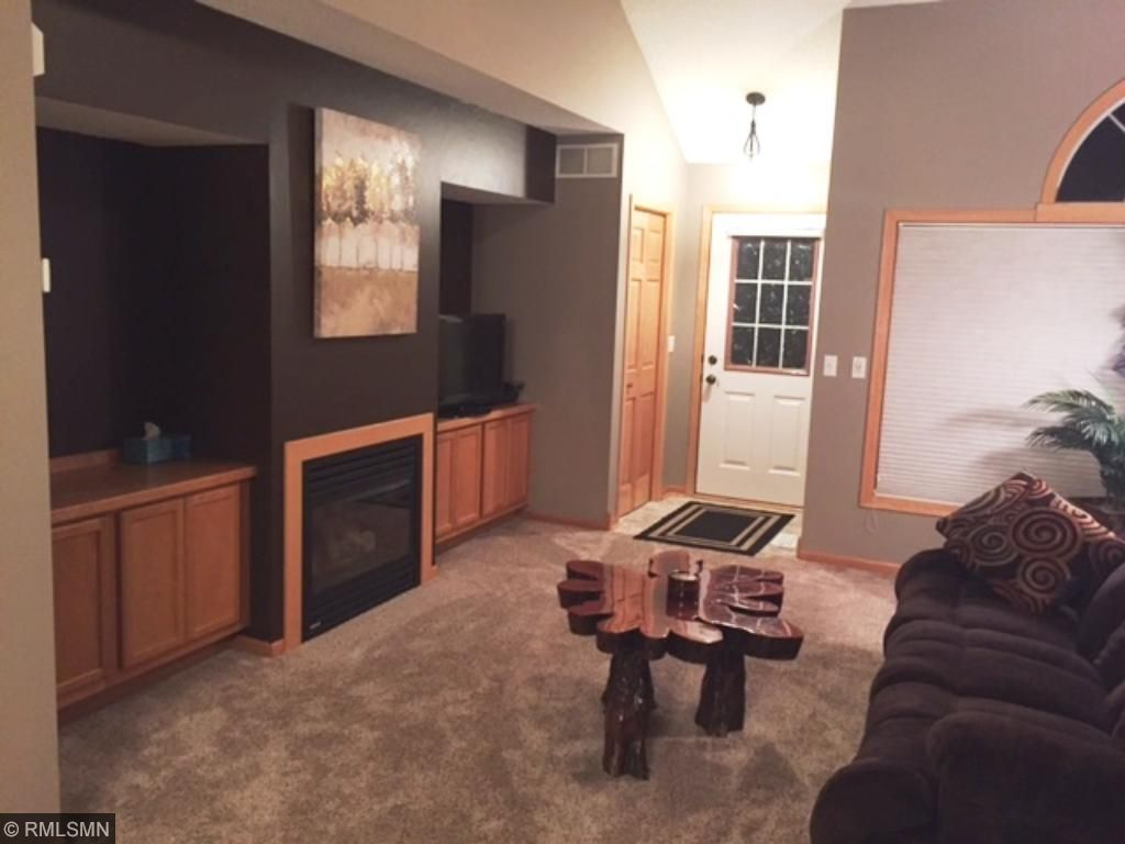 Vaulted ceiling and gas fireplace. Freshly painted, new carpet with lots of cabinet space.