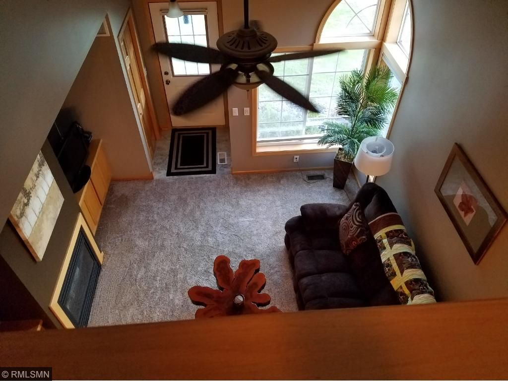 LR with ceiling fan and corner windows that brings great light!