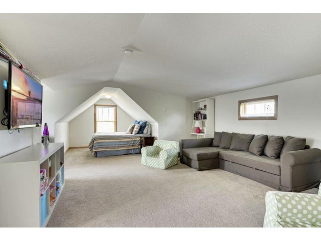 4 bedrooms up, including this bonus room that could be a bedroom OR simply an upper level family room and guest bedroom