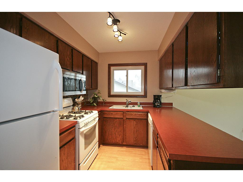 Kitchen with newer appliances.