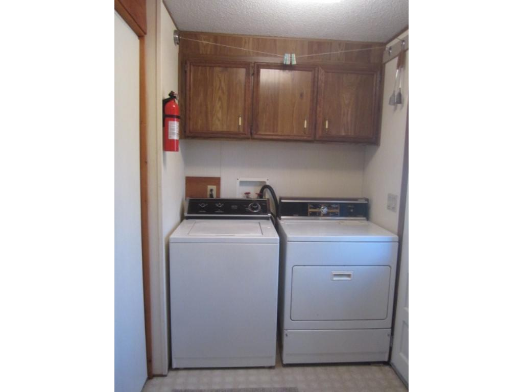 Main floor laundry room is located at back door entry to the home.