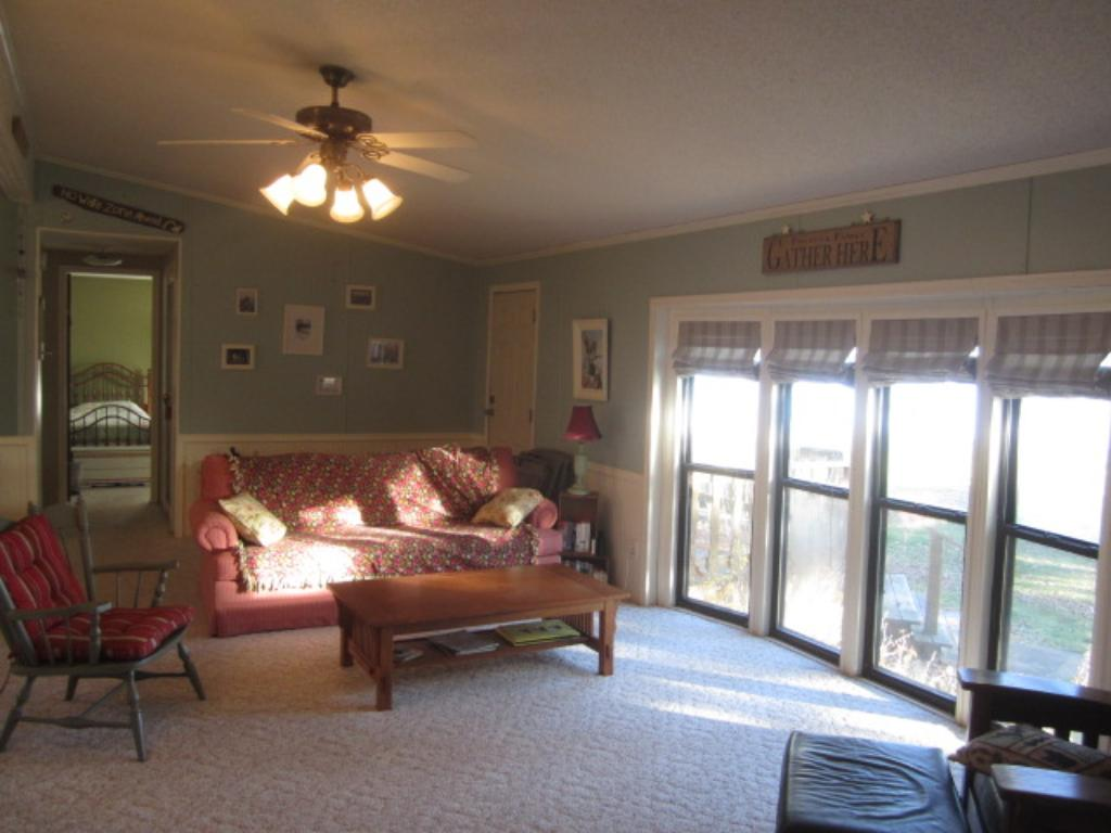 View of one end of the living room - further back in this photo are the other 2 bedrooms and full bath - a convenient layout for guests, family, and friends!