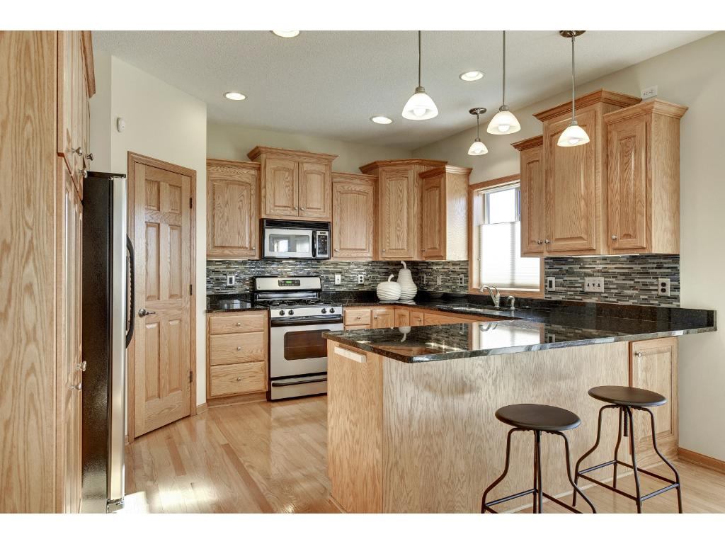 Perfect kitchen with granite, stainless and a corner pantry.