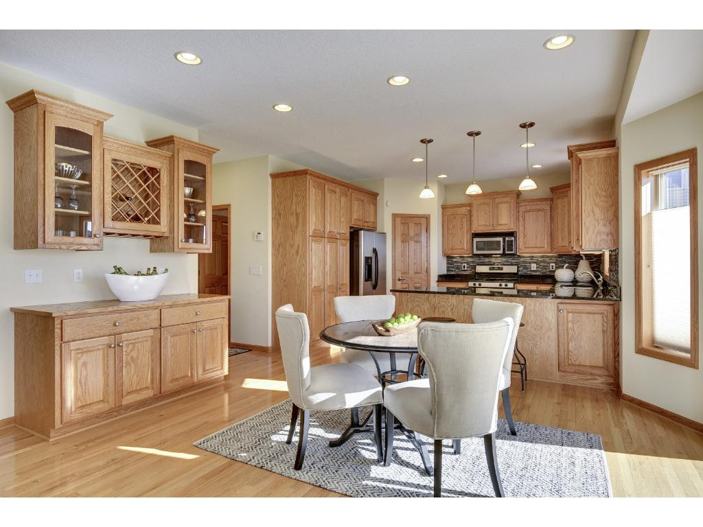 Additional storage cabinets and serving counter in dining area.