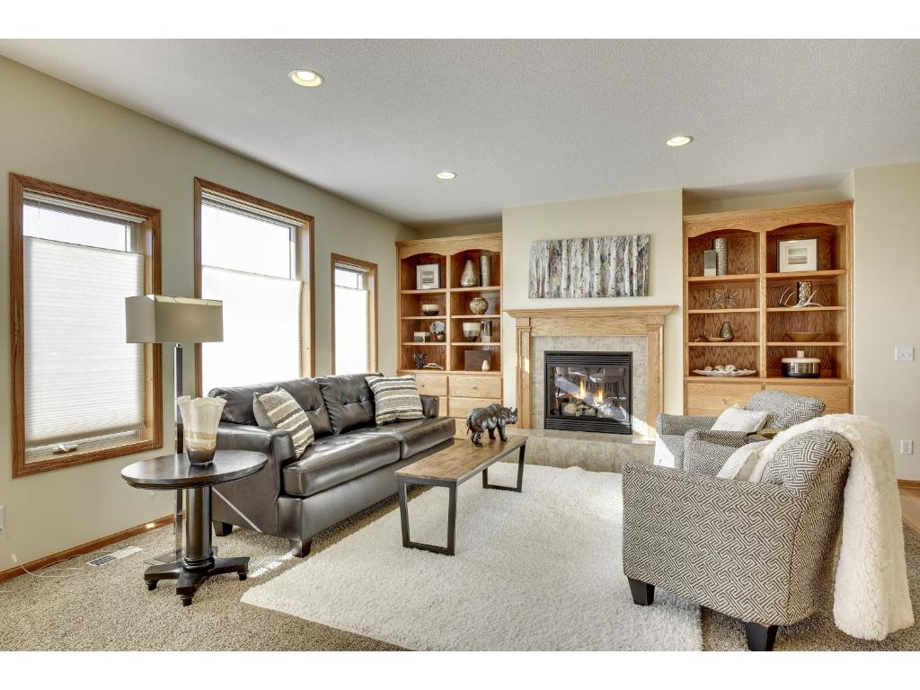 Large windows for natural light and cozy gas fireplace in the great room.
