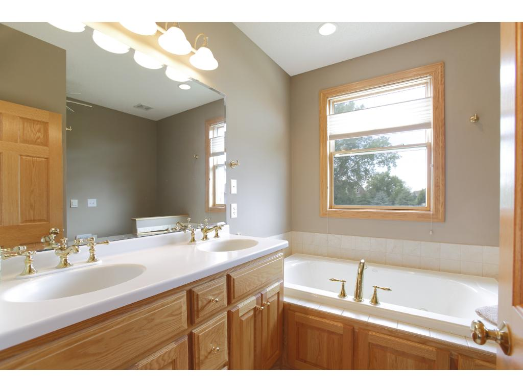 The private master bathroom features double sinks, and separate tub & shower.