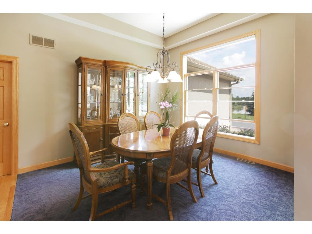 The light-filled main floor dining room features a tray ceiling.