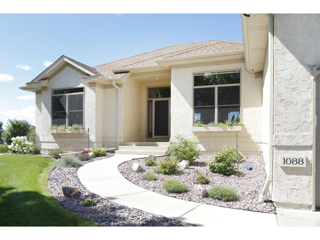 This home has been loving maintained and features beautiful landscaping.