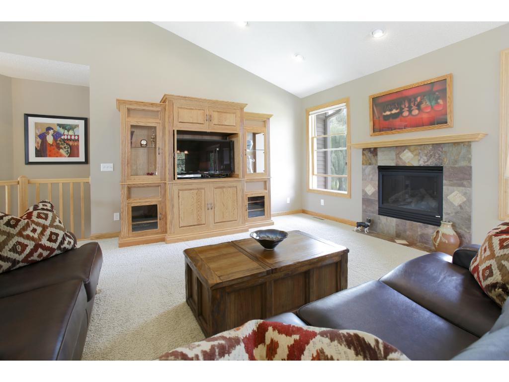 The open, main floor great room has a vaulted ceiling, a gas fireplace and south-western exposure.