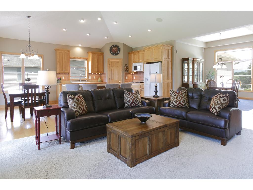 Here is another view of the main floor great room in to the open kitchen. Great space for entertaining year round.