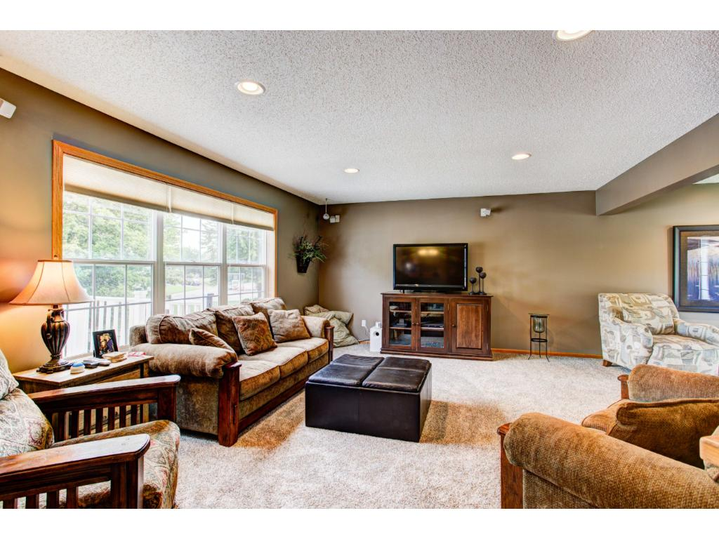 Main floor Family Room features oak columns and is open to the Kitchen and Living Room