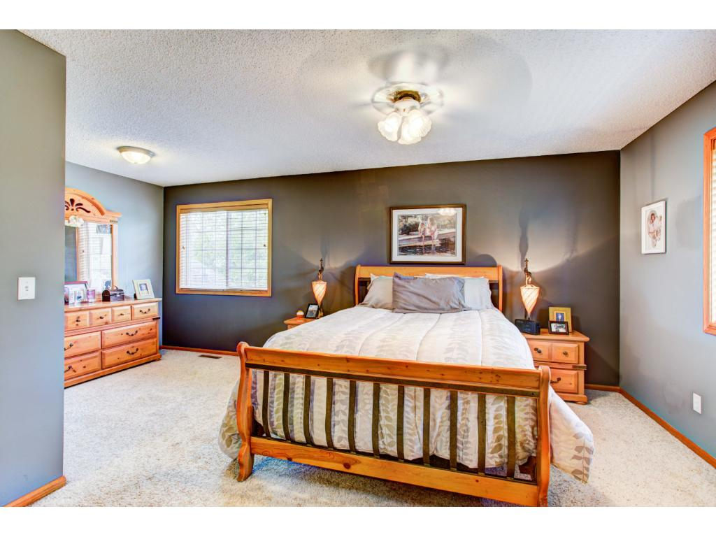 4 bedrooms on the upper level including the Master Suite with a walk-in closet and private Whirlpool bath