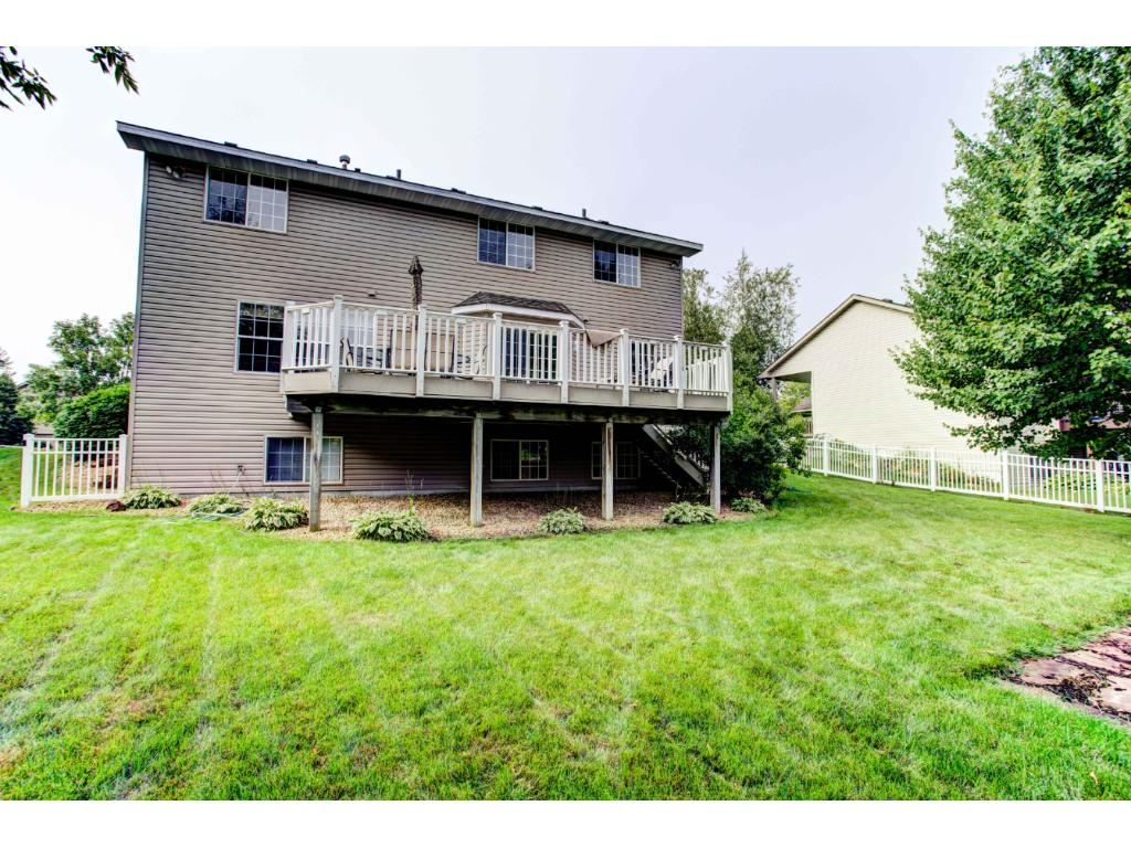 You will enjoy relaxing and entertaining on the large maintenance-free deck that overlooks the fenced backyard with mature shade trees and fire-pit