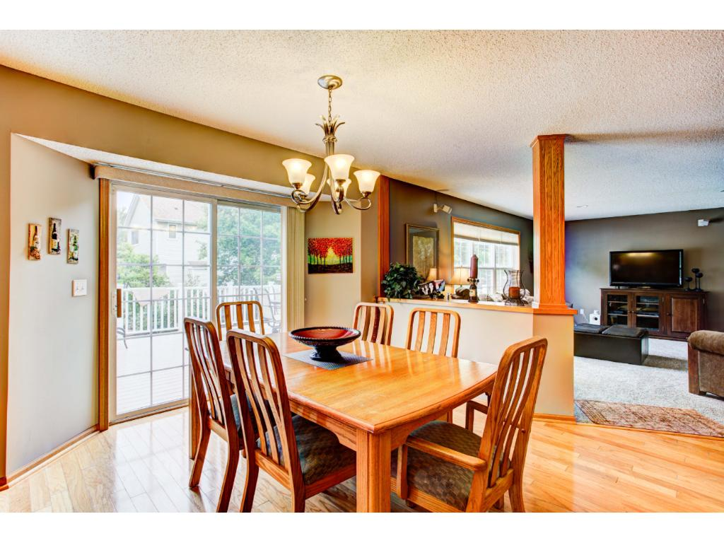 Spacious and light-filled eat-in Kitchen is open to the Family Room and features a bayed dinette with a patio door to the maintenance-free deck