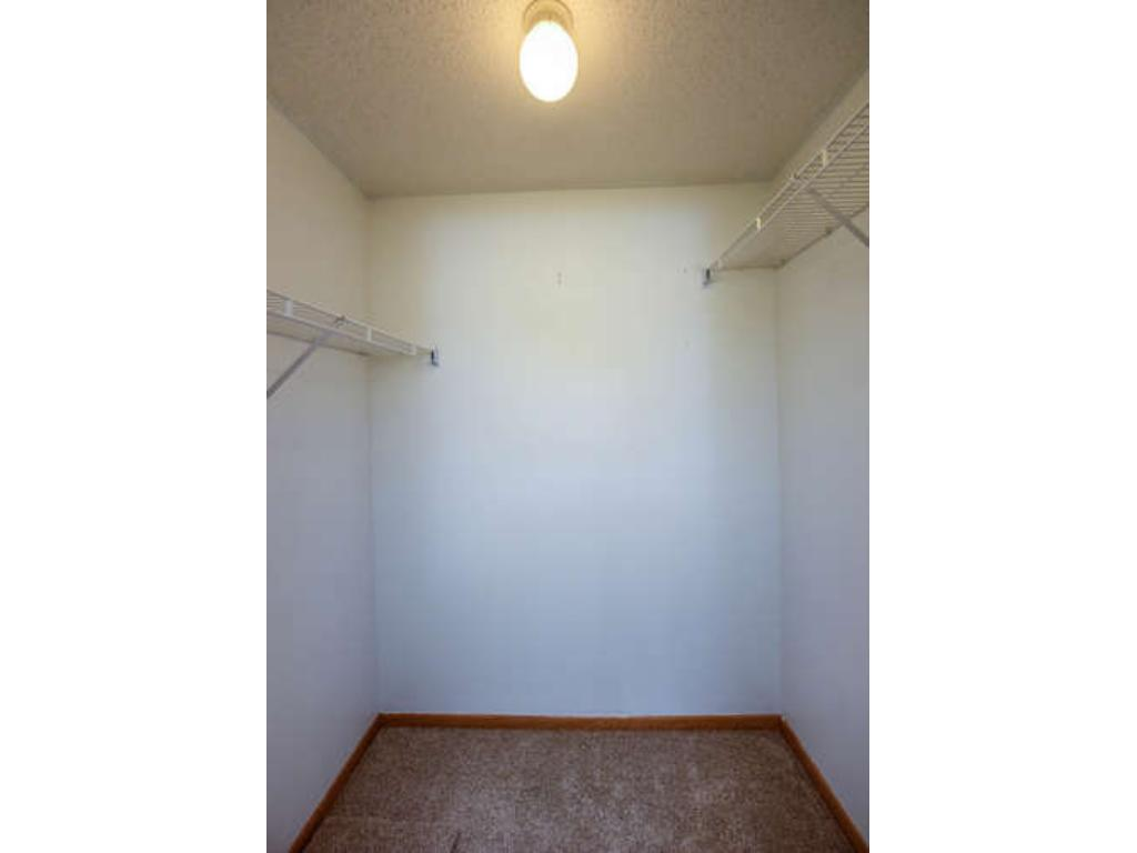 Spacious walk-in closet located in the master bedroom.