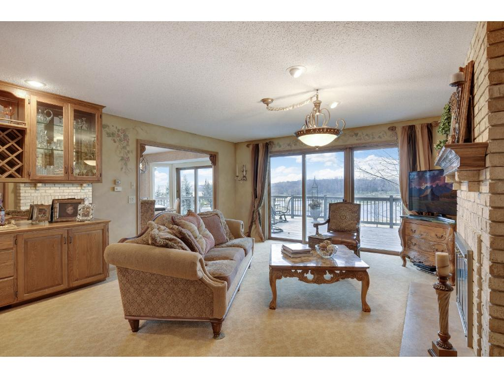 Main level family room has amazing views and the brick fireplace with realistic gas insert. The walls in the main living areas have artisan finishes and professionally done, Italian Fresco artworks throughout.