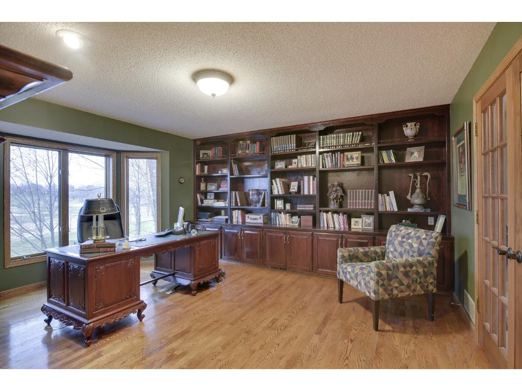 Den with Mahogany desk, French doors to the living room and a great view of the course.
