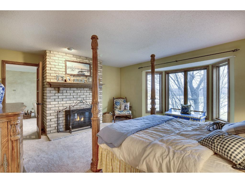 Master bedroom is over 30 feet long a includes a double sided fireplace and sitting room with balcony overlooking the course.