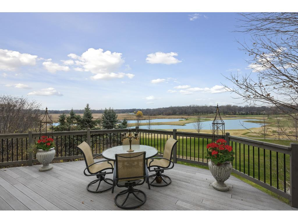 Premier lot on Olympic Hills.  Panoramic views of the course, ponds and natural beauty are fully incorporated with the layout of the home and the 3 levels of decks and walkout lower level.