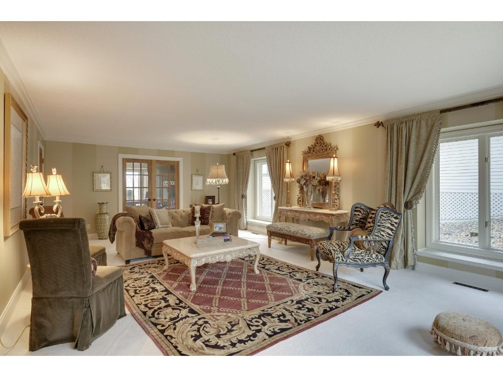 Living room is almost 30 feet long, with hand carved corbels and crown molding.  Like all the rooms, you can close the 3 sets of glass French doors for an intimate gathering.