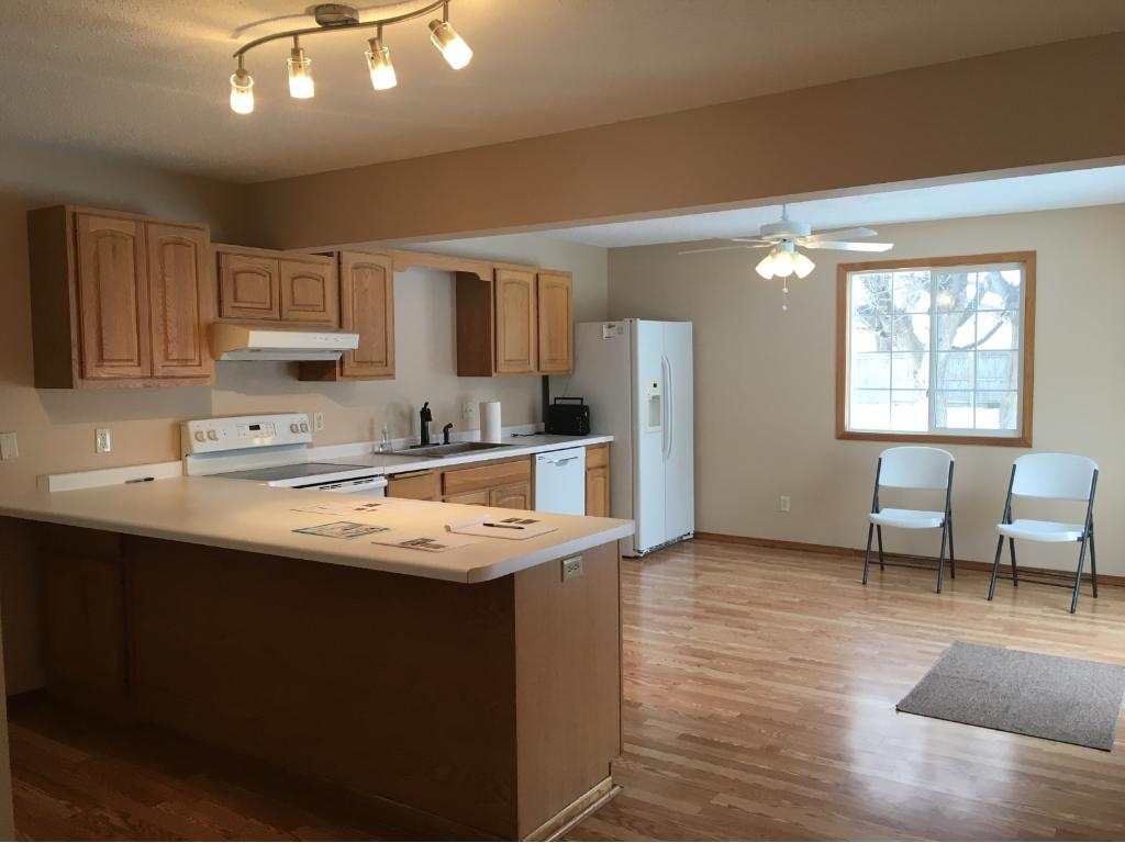 Spacious kitchen with new dishwasher and stove