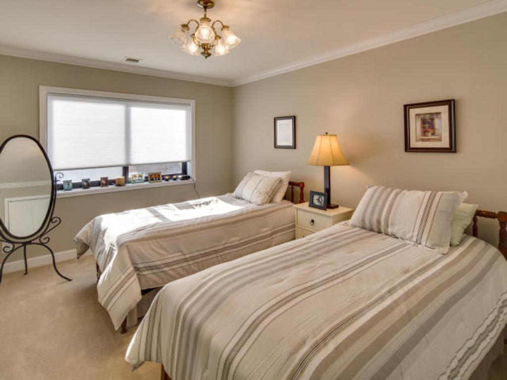 Guest bedroom has two beds for guests