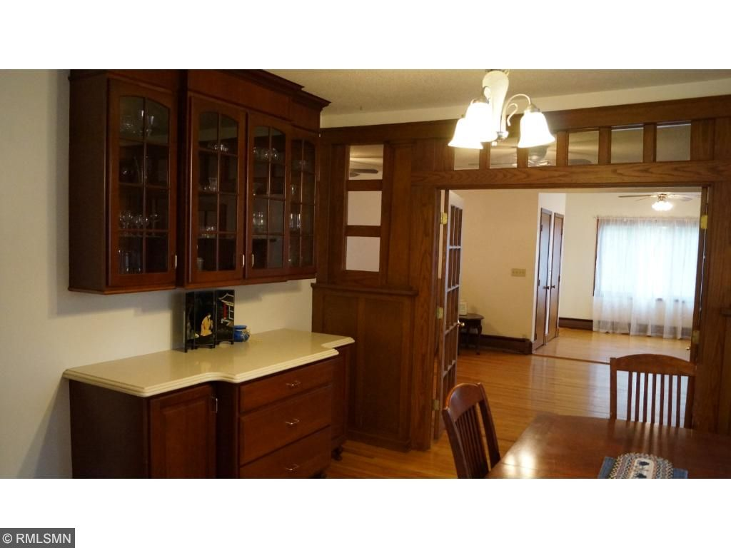 The kitchen has an abundance of cherry wood cabinetry.